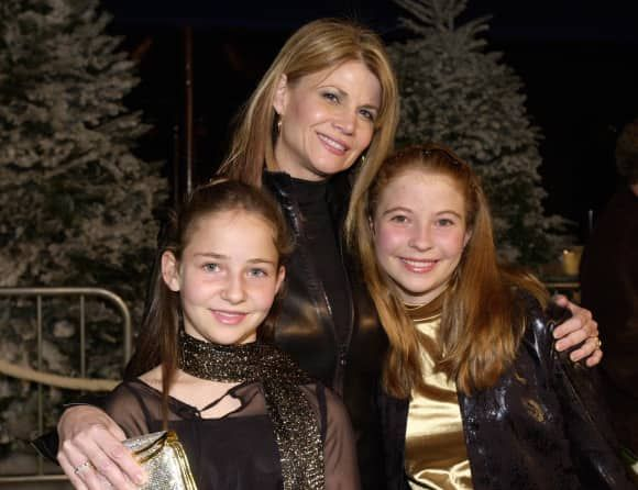 Markie Post posing with her beautiful daughters